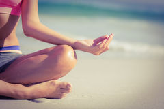 Close up view of fit woman doing yoga beside the sea Stock Photography