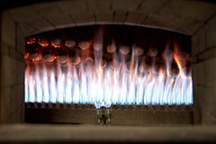 Close up view of the flames in an open bakery oven Stock Photography