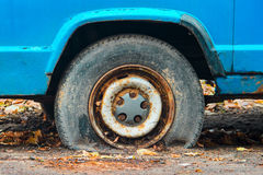 Close-up view flat rear tire on a car Royalty Free Stock Images