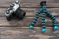 Close up view of a flexible type tripod and vintage camera Royalty Free Stock Photo