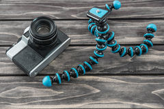 Close up view of a flexible type tripod and vintage camera Royalty Free Stock Image