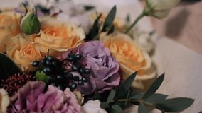 Close up view of florist preparing flower composition at workplace, roses for valentine`s day and women`s day stock footage