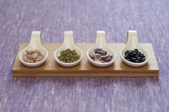 Close-up view of four different variety of Organic Beans Stock Photo