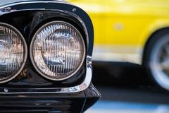 Close up view of a fragment a round headlights of retro car stock photography