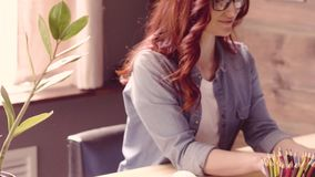 Close up view of freelancer woman sitting at table, working. stock video footage