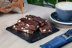 Close up view on fresh homemade Italian Christmas dessert panforte with nuts. stock photo