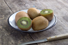 Close up view of fresh kiwis fruits. Cut in half royalty free stock photography
