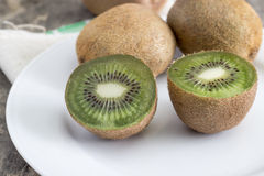Close up view of fresh kiwis fruits. Cut in half stock images