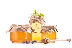 Fresh honey in glass jars royalty free stock photography