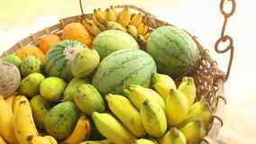 Close up view of fruit basket swinging in the wind in Weligama, Sri Lanka. Tropical fruit is available all year round. stock video footage