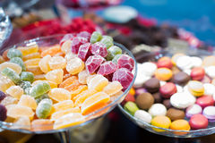 Close up view at fruit jellies and macaroons Stock Photography