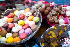 Close up view at fruit jellies and macaroons Royalty Free Stock Photo