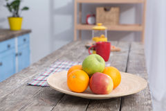Close up view on fruit on a table at kitchens wooden table. Royalty Free Stock Photo
