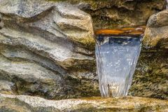 Water Feature. A close up view of a garden water feature cascading down stock image