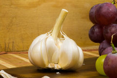 Close up view of garlic and red and yellow muscat colored grapes Stock Photos
