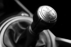 Close up view of a gear lever shift. Manual gearbox. Car interior details. Car transmission. Soft lighting. Abstract view. Black Royalty Free Stock Images
