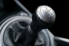 Close up view of a gear lever shift. Manual gearbox. Car interior details. Car transmission. Soft lighting. Abstract view stock image