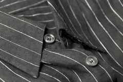 Close up view of a generic black business shirt with a line pattern Stock Photo
