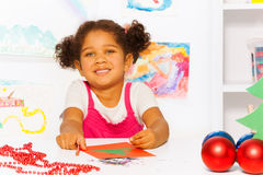 Close up view of girl with Christmas carton card Stock Photos