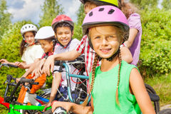 Close up view of girl in helmet and her friends Royalty Free Stock Images