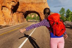 Close-up view of girl hitch-hiking near Red canyon Royalty Free Stock Photo