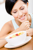 Close up view of girl near the plate with cereals Stock Photo