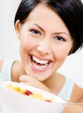 Close up view of girl near the plate with muesli Stock Photography