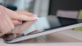 Close up view of a girl using her tablet. stock images