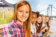Close up view of girl who sits with other friends Royalty Free Stock Photos