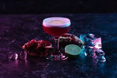 Close-up view of glass with conchita cocktail and ingredients. On dark surface royalty free stock photos