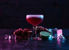 Close-up view of glass with delicious conchita cocktail and ingredients on dark surface stock photos