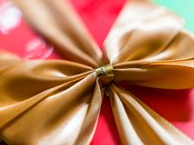 Close-up view of gold ribbon or bow on red gift box royalty free stock images