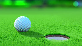 Close up view of a golf ball on the green near the hole Royalty Free Stock Photography