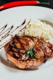 Close-up view of gourmet juicy grilled steak with rosemary. On plate stock photos