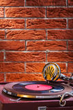 Close up view on gramophone on background of the brickwall stock photo