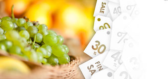 Close up view of grape and oranges. offer of the week Royalty Free Stock Photography