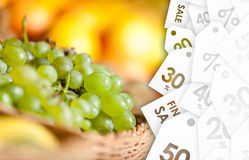 Close up view of grape and oranges on sale Royalty Free Stock Photography