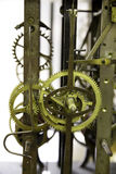 Close up view of greasy and rusty old wall clock mechanism with gears Royalty Free Stock Image