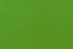 Close-up view of the green color natural cloth. Aida texture  Royalty Free Stock Image