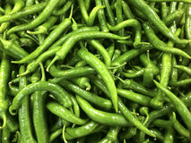 Close up view of green peppers at a market Royalty Free Stock Photography