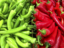 Close up view of green and red peppers at a market Stock Photos