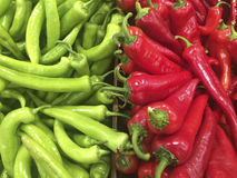 Close up view of green and red peppers at a market Royalty Free Stock Images
