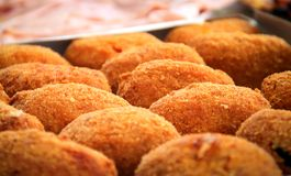 Close-up view of a group of fried rice balls. Sicilian arancini Royalty Free Stock Images