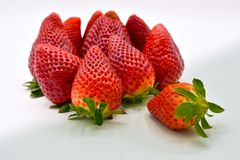Close up view of a group of several tasty fresh red strawberries just harvested and ready to be eaten. The strawberries are put stock image