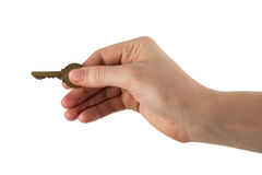Close up view of hand holding key to a dream house Stock Image