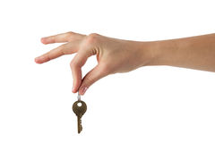 Close up view of hand holding key to a dream house Royalty Free Stock Photography