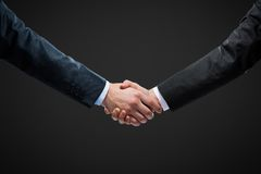 Close up view of hand shake Stock Photos