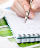 Close up view of hand writing in the notebook stock photo