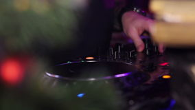 Close up view of the hands of a DJ mixing music on his deck with his hands stock video