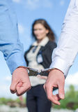 Close up view of hands in handcuffs Stock Photo